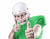 Football Player on green uniform isolated on white background — Stock Photo