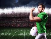 Football Player on green uniform in the stadium — Stock Photo
