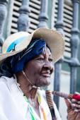 Portrait of african cuban woman smoking cigar in Havana, Cuba — Stock Photo