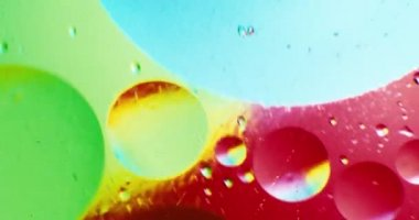 Oil drops floating in water over a colorful underground with oil painting effect. Shot on RED — Stock Video