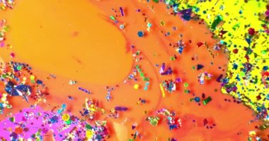 Color drops floating in oil and water over a colorful underground with oil painting effect. Shot on RED — Stock Video