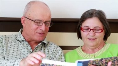 Senior Couple Watching Photo Album — Stock Video