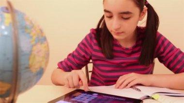 Schoolgirl doing her homework with digital tablet — Vídeo stock