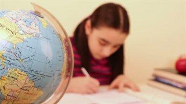 Schoolgirl doing her homework — Stock Video