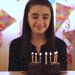 Young girl blowing candles on birthday cake — Stock Video #65378079