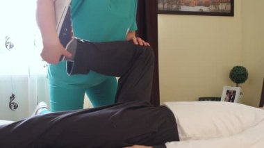 Physical therapist working with patient — Stock Video