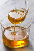Agave syrup pouring on a glass. — Stock Photo