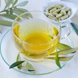 Olive leaf herbal tea  and olive leaf extract capsules . Dietary — Stock Photo #67915121