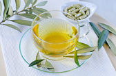 Olive leaf herbal tea  and olive leaf extract capsules . Dietary — Stock fotografie