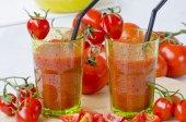 Tomato juice in glasses. — Stock Photo