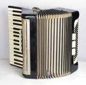 Black accordion opened — Stock Photo