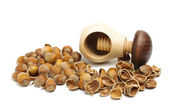 Nut cracker and the pile of nuts — Stock Photo