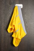 Messy yellow man underwear hanged on the wall — Stockfoto