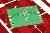 Printed circuit board PCB on red gerber mask for manufacturing — Stock Photo