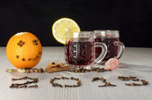 Gluhwein and hot wine spices on the table — Stock Photo