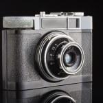 Analog amateur film camera with reflection studio shot — Stock Photo #63824939