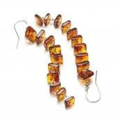 Vintage amber ear rings isolated — Stock Photo