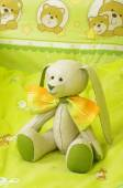 Original plush animal toy in the baby bed — Stock Photo