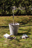 Limewash or whitewash equipment for early spring gardening — Stock Photo