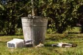 Tree whitening equipment on the grass — Stock Photo