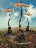 Fairy cottages with umbrellas — Stock Photo