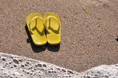 Flip flops on the sand — Stock Photo
