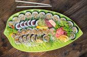 Fresh sushi on green platter — Stock Photo