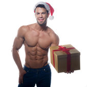 Muscular, sexy santa claus with gift on white background — Stock Photo