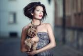 Portrait of a woman with a dog breed Yorkshire Terrier — Stock Photo