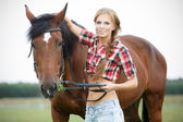 Beautiful smiling woman with horse chestnut — Stock Photo