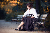 Woman in Victorian dress in the autumn park — Stock Photo