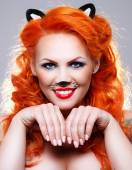 Cat woman with red hair — Stock Photo