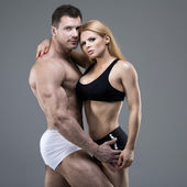 Sexy pair of athletic people — Stock Photo