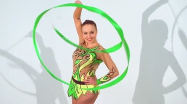 Beautiful acrobat dancing with a sash in slow motion — Stock Video