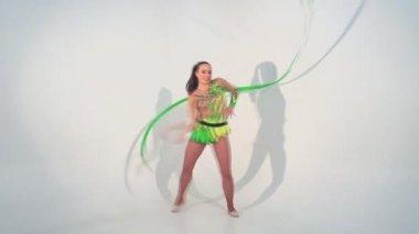Beautiful acrobat dancing with a sash — Stock Video