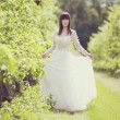 Woman in a white dress in the orchard — Stock Photo #76166733