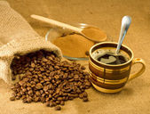 Ground coffee, beans and a cup of — Stockfoto