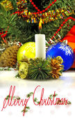 Candle on a Christmas tree background  — Stock Photo