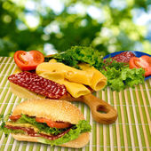 Sandwich, herbs, sausage, tomato and cheese — Stock Photo