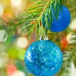 Two blue Christmas balls on spruce branch — Stock Photo #57969793