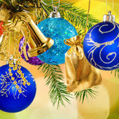Christmas decorations on a yellow background — Stock Photo