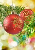 Image of Christmas balls on a multicolored background closeup — Stock Photo