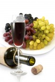 Bottle,  glass of wine and a plate with grapes — Stock Photo