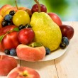 Various fruits on a table on green background — Stock Photo #58784307