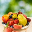 Image of various fruits on a table on green background — Stock Photo #58784365