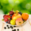 Various fruits on a green background closeup — Stock Photo #58789135