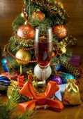 Christmas tree, candle and glass of wine — Stock Photo