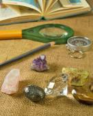 Minerals, atlas, magnifier, pencil and compass closeup — Stock Photo
