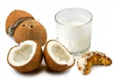 Coconut and milk on a white background — Stock Photo