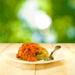 Delicious stuffed peppers on a green background — Stock Photo #77707310